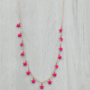 Collana Stelline by StellaBloom NY. Tendenza moda Primavera Estate 2018. Girocollo in acciaio color oro rosa cm. 40 con 15 stelline smaltate da ambo i lati.